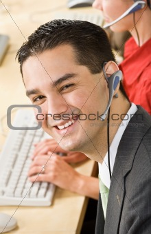 Businessman talking on headsets