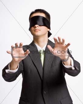 Businessman in blindfold