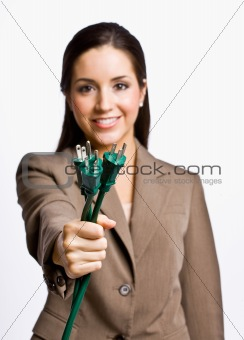Businesswoman  holding electrical plugs