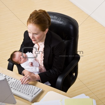 Businesswoman With Baby at Desk