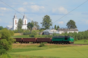 Freight train passing the village