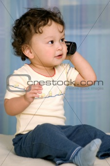 Baby with telephone.