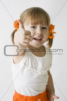 Little girl making the OK sign
