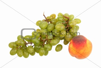 Green grapes bunch and one orange peach.