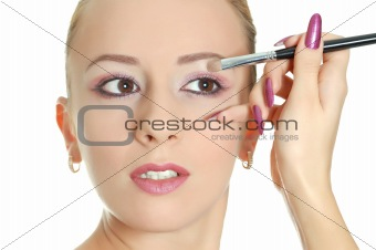 Attractive woman with brush