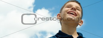 smiling boy at the clouds