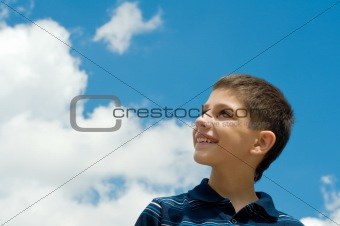 boy at the clouds