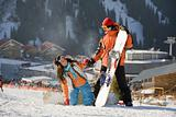 Lucky couple  snowboarders  in a mountain valley