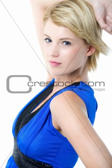Beautiful young woman in blue cocktail dress.