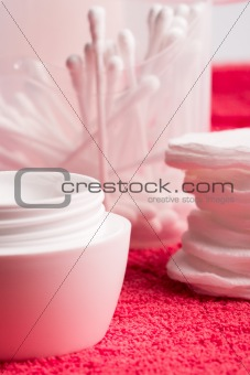 facial cream and cotton pads