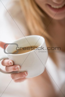 Close-up of Woman Holding White Coffee Mug
