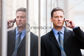 Business man's reflection on the phone