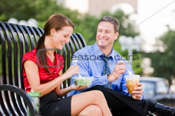 Businessman and Businesswoman Taking a Lunch Break