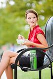 Woman taking her lunch break outside