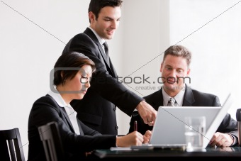 Three Business Associates Working Together