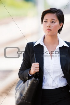 Business woman walking outside