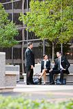Three Business Professionals Outside Office Building
