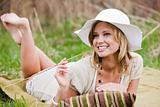 Woman With Hat Reclining in Meadow