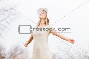 Blonde Woman Standing Outside With Arms Outstretched