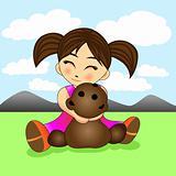 cute little girl hugging a teddy bear