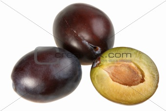 Three dark-purple plums.
