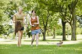 Women walking dog at a park