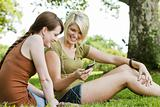 Women listening to music at park