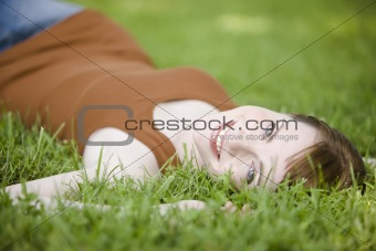 Woman lying down of grass