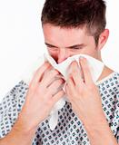 Patient with flu using a tissue