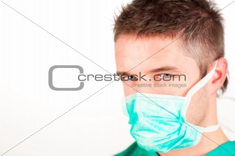 Attractive surgeon with mask looking at the camera