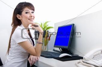 beautiful secretary with blank computer screen