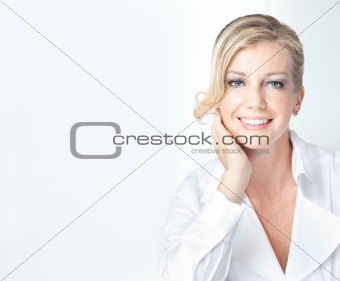 Blonde mature business woman with welcoming smile