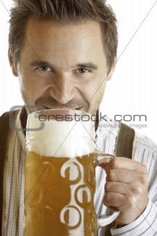 Bavarian man holding Oktoberfest beer stein