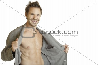 ATHLETIC MAN PUTS OFF JACKET