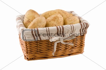 Potatoes in basket isolated, clipping path.