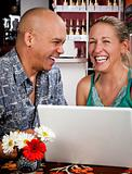 Couple in Coffee House with Laptop Computer