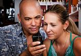 Couple in Coffee House with Cell Phone