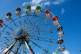 A colorful big fun wheel against blue sky
