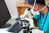 Asian Woman Doctor or Scientist Using a Microscope In Laboratory