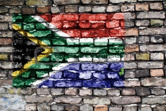 Flag of South Africa on old brick wall