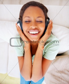 Top view of a young female enjoying music on the headphones