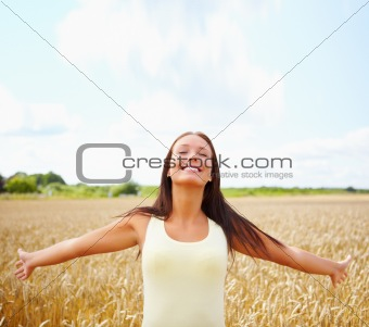 Cute female with her hands raised out in the open farm