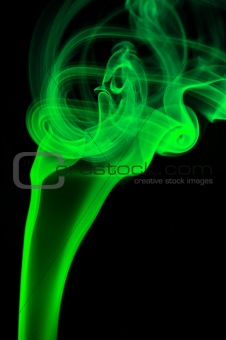 Abstract green smoke over black background