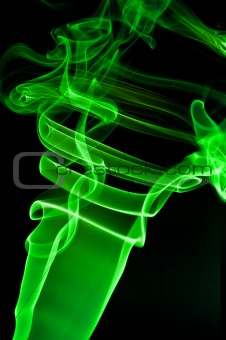 abstract green smoke . black background