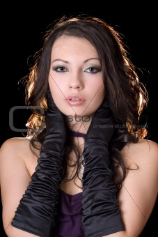 Portrait of the beauty young woman over black