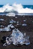 Icebergs Breaking On Black Sand Beach In Iceland