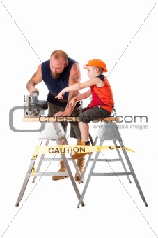 Dad with son and circle saw