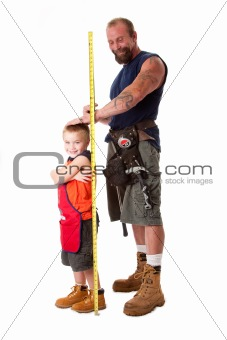 Dad measuring height of son