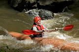 girl white water kayaking
