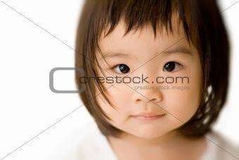 innocent asian baby face